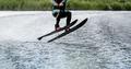 man waterskiing on lake behind boat - PhotoDune Item for Sale