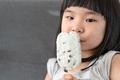 Cute toddler girl eating ice cream - PhotoDune Item for Sale