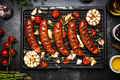 Grilled BBQ Sausages with Spices,Herbs and Vegetables. Top View on Grill - PhotoDune Item for Sale