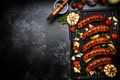 Grilled Meat Sausages with Vegetables and Herbs. BBQ Food Border Background. Top View - PhotoDune Item for Sale