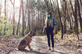 Woman Play with Dog Outdoor  Wearing Face Mask. Coronavirus New Normal. - PhotoDune Item for Sale