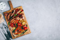 Barbeque food. Grilled sausages and vegetables on  wooden board - PhotoDune Item for Sale
