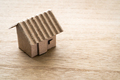 Model of cardboard house on wooden background - PhotoDune Item for Sale