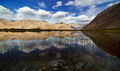 Reflections of the mountains in a natural pond, Nubra Valley , Jammu and Kashmir, India - PhotoDune Item for Sale