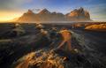 Vestrahorn mountain with black volcanic lava sand dunes at sunset, Stokksnes, Iceland - PhotoDune Item for Sale