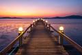 Wooden bridge of Chan Damri Beach at sunset ,Ranong ,Thailand - PhotoDune Item for Sale