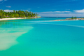 Palm trees on a white sandy beach at Plantation Island, Fiji, South Pacific - PhotoDune Item for Sale