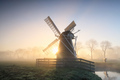 charming Dutch windmill in fog at dawn - PhotoDune Item for Sale