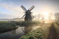 windmill in fog by river and road - PhotoDune Item for Sale