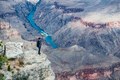 A Man Standing on the Rim of the Grand Canyon - PhotoDune Item for Sale