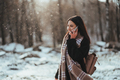 Woman talking on mobile phone. Smiling girl talking on mobile phone in cold winter day - PhotoDune Item for Sale