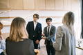 Group of business people in a meeting standing grouped in a office - PhotoDune Item for Sale