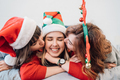 Portrait of three women friends wearing leisure clothing hugging together and kissing in cheeks - PhotoDune Item for Sale