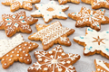 Christmas ginger cookies in the shape of snowflakes, decorated with various aisings - PhotoDune Item for Sale