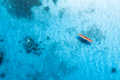 Aerial view of the fishing boat in transparent blue water - PhotoDune Item for Sale