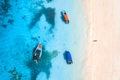 Aerial view of the fishing boat in clear blue water at sunset - PhotoDune Item for Sale