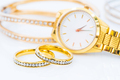 Luxury gold ring and lady gold watch on white_ - PhotoDune Item for Sale