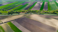 Agricultural Farm Fields Shapes. Aerial Drone view of Farmlands in Countryside - PhotoDune Item for Sale