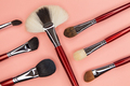 set of brushes for applying cosmetics on a pink background - PhotoDune Item for Sale