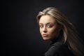 Dramatic studio portrait of beautiful young woman on dark background - PhotoDune Item for Sale