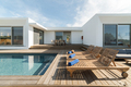 Lounge chairs in modern villa pool - PhotoDune Item for Sale