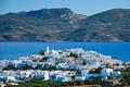 View of Plaka village with traditional Greek church. Milos island, Greece - PhotoDune Item for Sale