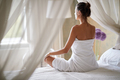 Girl  with facial mask doing yoga at morning in bed - PhotoDune Item for Sale