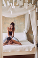 smiling men lying on bed and woman making massage. - PhotoDune Item for Sale