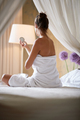 woman relaxing in bed at home sitting in bed and looking at mirror. - PhotoDune Item for Sale