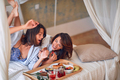 Fun morning in bed. Funny woman enjoying in morning breakfast. - PhotoDune Item for Sale