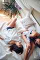 Lesbian couple at home lying in bed.Love and Relationships. - PhotoDune Item for Sale