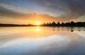 beautiful sunrise reflected in big forest lake - PhotoDune Item for Sale