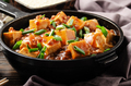 Mapo tofu in cast iron skillet with pork chopped chives soy sauce sichuan pepper garlic and spices - PhotoDune Item for Sale