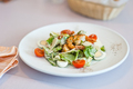 Shrimp salad in a white plate on a table at cafe. Shallow depth of field - PhotoDune Item for Sale