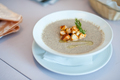Cream soup with mushrooms champignon and potato in white bowl. Shallow depth of field - PhotoDune Item for Sale