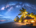Milky Way over the sandy beach with palm trees and sunbeds - PhotoDune Item for Sale