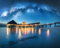 Milky Way and wooden bungalow on the water in summer starry night - PhotoDune Item for Sale
