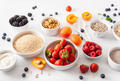 raw cereals, fruits for breakfast. Oatmeal flakes and steel cut, barley, walnut, chia, apricot - PhotoDune Item for Sale