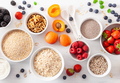 raw cereals, fruits and nuts for breakfast. Oatmeal flakes and steel cut, barley, walnut, chia - PhotoDune Item for Sale
