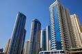 Dubai Marina skyscrapers in a sunny day, clear blue sky in Dubai - PhotoDune Item for Sale