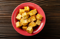 Flat lay closeup view at crispy deep stir fried tofu cubes with chives in clay dish - PhotoDune Item for Sale