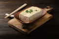Soybean tofu vegetable bean curd in clay bowl on kitchen table with chives and chopsticks aside - PhotoDune Item for Sale