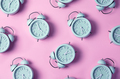 Creative layout of blue alarm clock's on pastel pink background. Minimal concept - PhotoDune Item for Sale