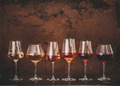 Shades of Rose wine in glasses, rusty background, copy space - PhotoDune Item for Sale