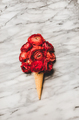 Ice cream waffle cone with scoop of red ranunculus flowers - PhotoDune Item for Sale
