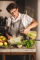 Elderly woman making fresh homemade lemonade over kitchen counter - PhotoDune Item for Sale