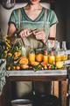 Young woman making fruit immune boosting drink to resist virus - PhotoDune Item for Sale
