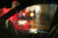 Lights of night city through the glass of the car with raindrops - PhotoDune Item for Sale