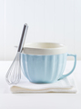 Blue mixing bowl with wisp for baking on white background - PhotoDune Item for Sale