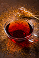 Cup of delicious rooibos tea on dark background - PhotoDune Item for Sale